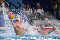 <p>Spain's Miguel de Toro Dominguez (R) vies with USA's Hannes Daube during the Tokyo 2020 Olympic Games men's water polo quarter-final match between the USA and Spain at the Tatsumi Water Polo Centre in Tokyo on August 4, 2021. (Photo by Angela WEISS / AFP)</p>