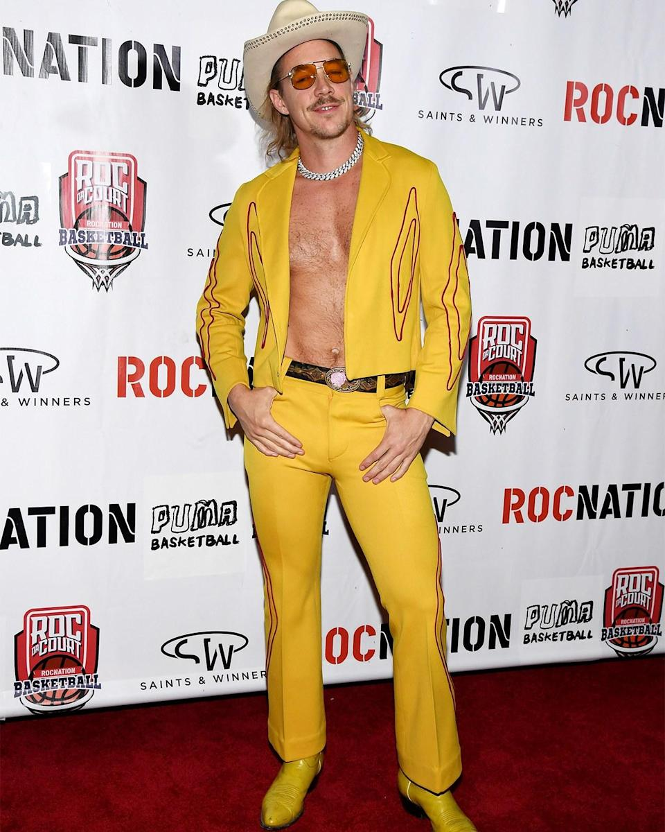 """<h1 class=""""title"""">April 25: Diplo</h1> <div class=""""caption""""> A hearty yeehaw to Diplo, seen here shortly before taking his horse down to the old town road. </div> <cite class=""""credit"""">Ethan Miller</cite>"""