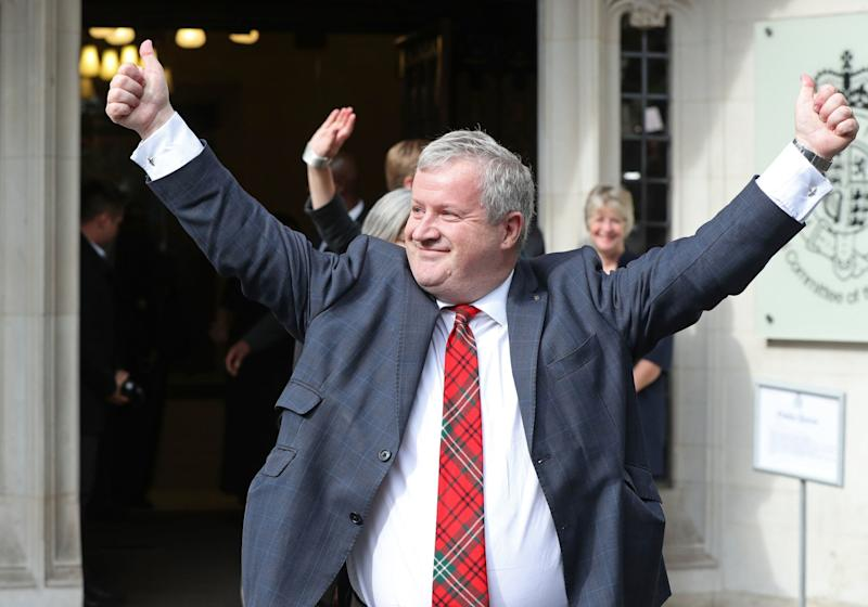 SNP Westminster leader Ian Blackford MP celebrated outside the court (PA)
