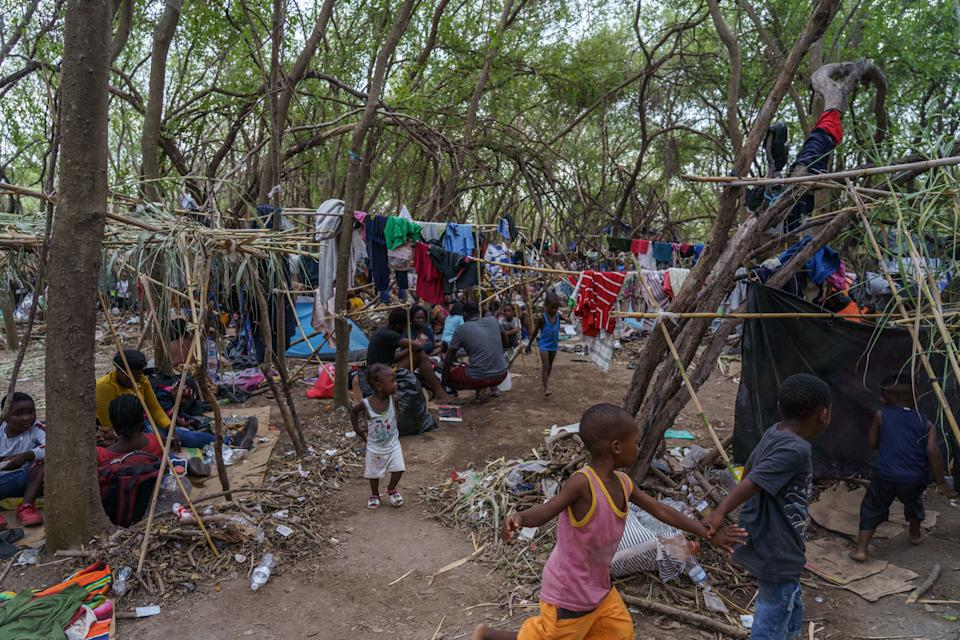Haitian migrants are pictured in a makeshift encampment where more than 12,000 people hoping to enter the United States await under the international bridge in Del Rio, Texas on September 21, 2021. (Paul Ratje/AFP via Getty Images)