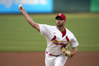 St. Louis Cardinals starting pitcher Adam Wainwright throws during the first inning of a baseball game against the New York Mets Monday, May 3, 2021, in St. Louis. (AP Photo/Jeff Roberson)