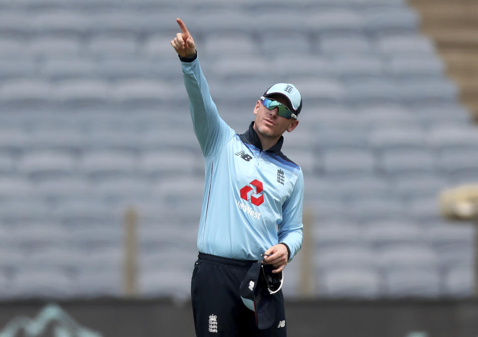 England's captain Eoin Morgan gestures to his teammates during the first One Day International cricket match between India and England at Maharashtra Cricket Association Stadium in Pune, India, Tuesday, March 23, 2021. (AP Photo/Rafiq Maqbool)