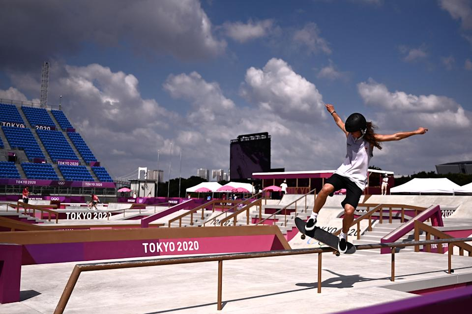 <p>Skaters warm up ahead of the women's street preliminary round during the Tokyo 2020 Olympic Games at Ariake Sports Park Skateboarding in Tokyo on July 26, 2021. (Photo by Jeff PACHOUD / AFP)</p>