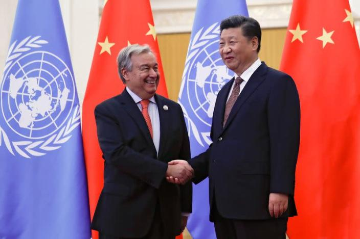 FILE PHOTO: UN SG Guterres and China's President Xi in Beijing