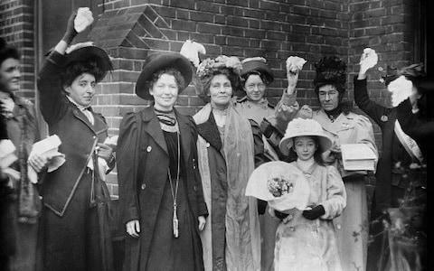 Emmeline Pankhurst and her daughter Christabel , the English suffragettes, with some of their supporter - Credit: Corbis via Getty