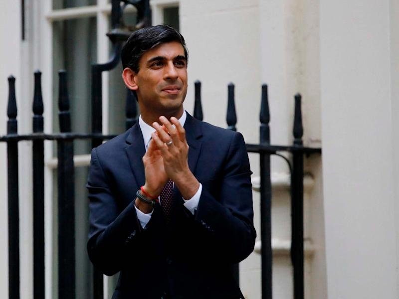 """Rishi Sunak participates in a national """"clap for carers"""" to show thanks for the work of Britain's NHS workers: AFP via Getty Images"""