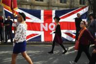 Loyalists march past a Union flag during a pro-Union rally in Edinburgh, Scotland September 13, 2014. REUTERS/Dylan Martinez