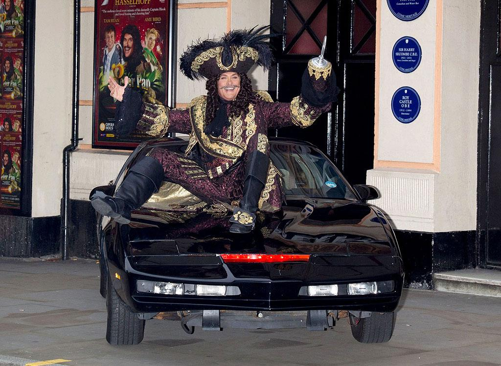 "CAPTAIN HOFF! David Hasselhoff gets into character as Captain Hook as he poses with the KITT car from ""Knight Rider"" outside the Opera House in Manchester"
