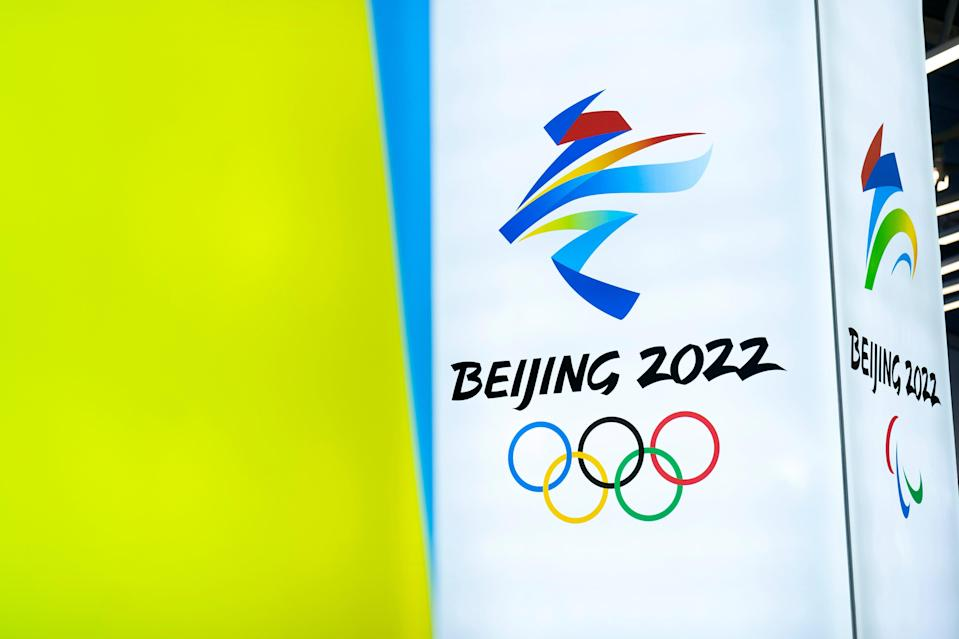 In this 5 Feb, 2021, file photo, the logos for the 2022 Beijing Winter Olympics and Paralympics are seen during an exhibit at a visitors center at the Winter Olympic venues in Yanqing on the outskirts of Beijing (AP)