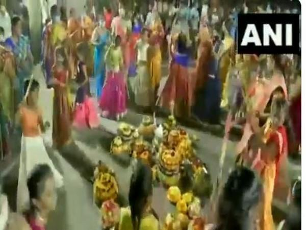 Women gather and dance around Batukammas in several places in Hyderabad. Photo/ANI