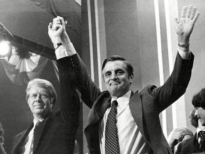 <p>Mondale (right) with Jimmy Carter at the Democratic Convention in 1976</p> (Shutterstock)