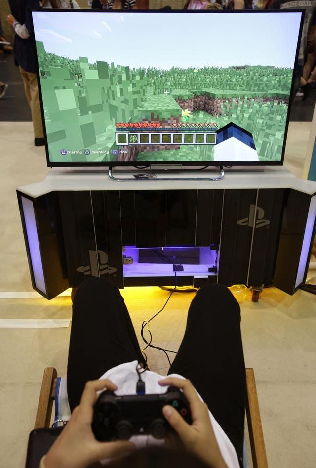 A visitor playing a game of Minecraft