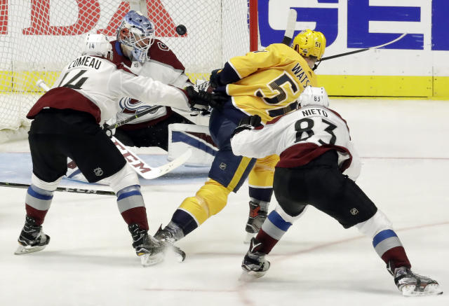 Nashville Predators left wing Austin Watson (51) scores a goal against Colorado Avalanche goaltender Jonathan Bernier during the third period in Game 2 of an NHL hockey first-round playoff series Saturday, April 14, 2018, in Nashville, Tenn. Avalanche's Blake Comeau (14) and Matt Nieto (83) also defend. (AP Photo/Mark Humphrey)