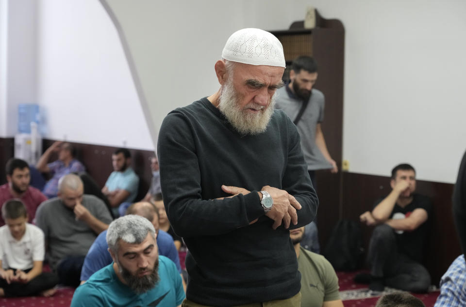Crimean Tatars pray ina mosque in Kyiv, Ukraine, Friday, Aug. 13, 2021. The fate of Crimean Tatars is one of the top issues at the inaugural meeting of the Crimean Platform on Monday Aug. 23, 2021, an international summit called by Ukraine to build up pressure on Russia over the annexation that has been denounced as illegal by most of the world. (AP Photo/Efrem Lukatsky)