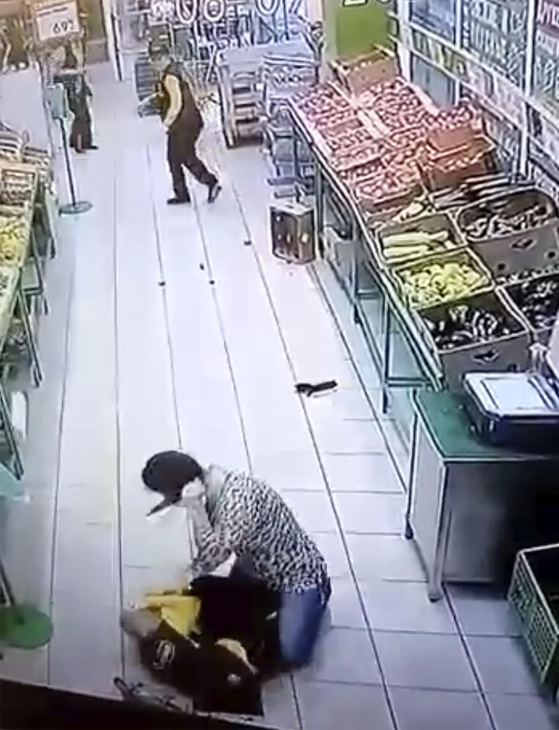 CCTV footage of the staffer being stabbed in the grocery store. Source: East2West News/Australscope