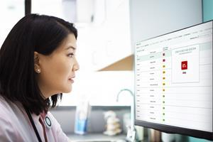 A doctor reviews the COVID-19 detection results of her patient's chest X-ray, showing this patient is 87% likely to have the virus. Photo credit Getty/Epic Systems Corporation