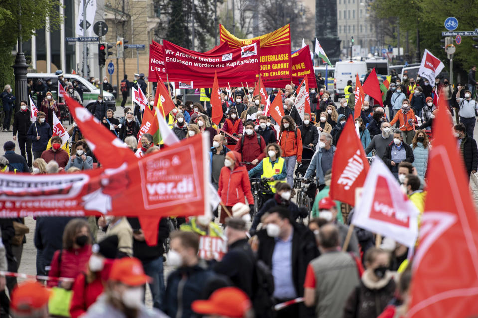 "Numerous participants march at a rally of the German Federation of Trade Unions (DGB) under the motto ""Solidarity is the Future"" in Munich, Saturday, May 1, 2021. (Matthias Balk/dpa via AP)"