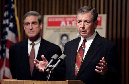 U.S. Attorney General John Ashcroft (R) and FBI Director Robert Mueller speak about possible terrorist threats against the United States, in Washington, May 26, 2004. REUTERS/Kevin Lamarque