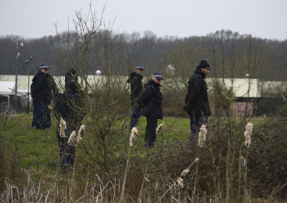 Officers from the Metropolitan Police search land near  Great Chart Golf and Lesiure, in connection with the disappearance of Sarah Everard. (Gareth Fuller /PA via AP)