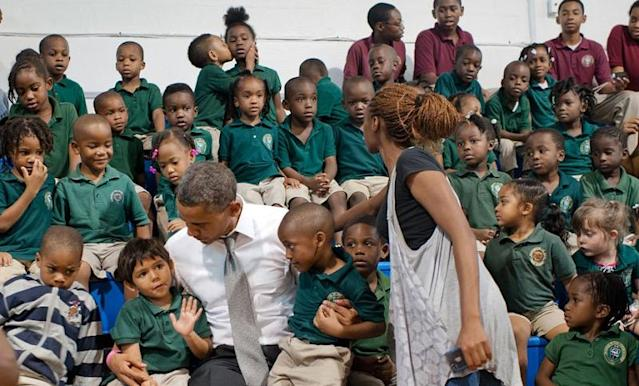 During his 2012 campaign, President Obama surprised students in Delray Beach, Fla., with an unscheduled stop to take a photo with the kids. But perhaps the biggest surprise of this photo op was the kissing pair in the back row photobombing the president. (@BarackObama/Twitter)