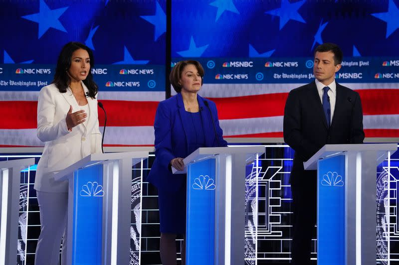 Democratic U.S. presidential candidates Rep. Tulsi Gabbard speaks as Senator Amy Klobuchar and South Bend Mayor Pete Buttigieg listen during their fifth 2020 campaign debate at the Tyler Perry Studios in Atlanta