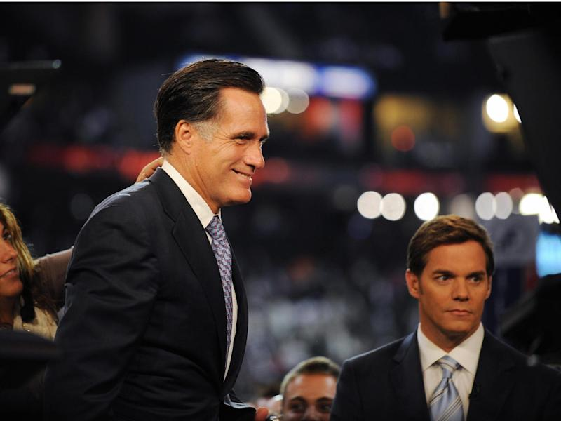 Former Republican presidential candidate and governor of Massachussetts Mitt Romney appears for an interview with Fox News anchor Bill Hemmer (R) on the floor at the Republican National Convention 2008 at the Xcel Energy Center in St. Paul, Minnesota, September 1, 2008.