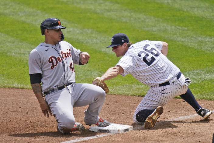 Detroit Tigers' Wilson Ramos, left, slides safely into third past New York Yankees third baseman DJ LeMahieu during the third inning of a baseball game at Yankee Stadium, Sunday, May 2, 2021, in New York. (AP Photo/Seth Wenig)