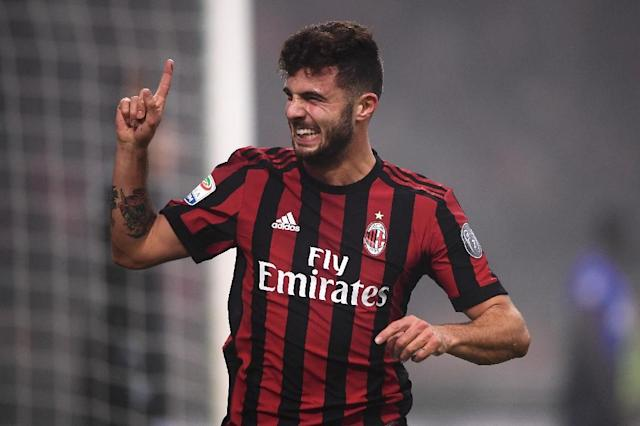 AC Milan coach has advised fast-rising forward Patrick Cutrone to get a girlfriend to help him deal with his newfound fame (AFP Photo/MARCO BERTORELLO)