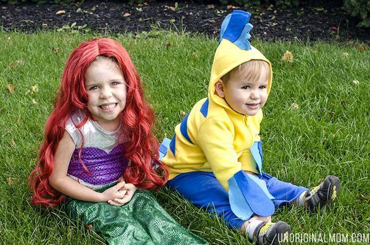 """<p>You may not be trick-or-treating under the sea, but you can sure feel like it with this Ariel and Flounder costume that will make everyone say """"aw."""" </p><p><a class=""""link rapid-noclick-resp"""" href=""""https://www.amazon.com/California-Costumes-peluca-disfraz-Sirenita/dp/B00CA6F5ZC/?tag=syn-yahoo-20&ascsubtag=%5Bartid%7C10055.g.33300912%5Bsrc%7Cyahoo-us"""" rel=""""nofollow noopener"""" target=""""_blank"""" data-ylk=""""slk:SHOP RED WIGS"""">SHOP RED WIGS</a> </p><p><em><a href=""""https://www.unoriginalmom.com/diy-little-mermaid-and-flounder-costumes/"""" rel=""""nofollow noopener"""" target=""""_blank"""" data-ylk=""""slk:Get the tutorial at Unoriginal Mom »"""" class=""""link rapid-noclick-resp"""">Get the tutorial at Unoriginal Mom »</a></em> </p>"""