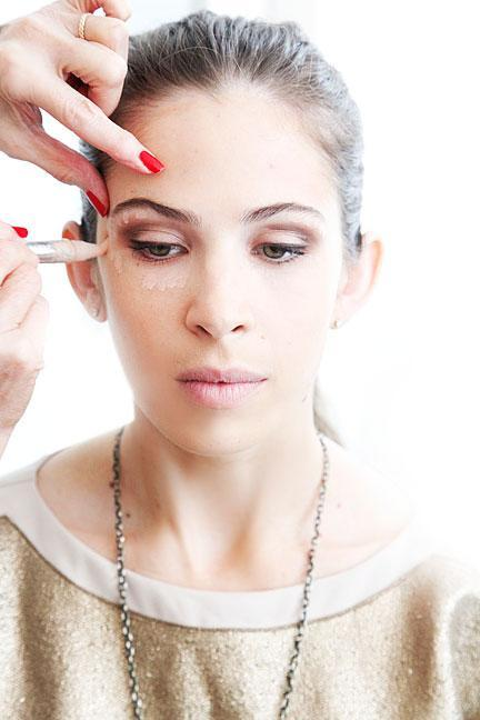 """<div class=""""caption-credit""""> Photo by: Photo: Kelly Stuart</div><div class=""""caption-title"""">Use Light Concealer</div><p> Brighten the eye area by using a sheer, translucent concealer or highlighter around the eye. One to try: <b><a rel=""""nofollow noopener"""" href=""""http://www.shopstyle.com/action/apiVisitRetailer?id=39414919&pid=uid400-1605520-78&utm_medium=widget&utm_source=Product+Widget"""" target=""""_blank"""" data-ylk=""""slk:Yves Saint Laurent Touche Éclat Radiant Touch"""" class=""""link rapid-noclick-resp"""">Yves Saint Laurent Touche Éclat Radiant Touch</a></b>. <br> </p><b><br> MORE <br> <a rel=""""nofollow noopener"""" href=""""http://www.elle.com/beauty/makeup-skin-care/bright-nail-polish-colors?link=emb&dom=yah_life&src=syn&con=blog_elle&mag=elm"""" target=""""_blank"""" data-ylk=""""slk:The Top Manicure Color for Your Skin Tone"""" class=""""link rapid-noclick-resp"""">The Top Manicure Color for Your Skin Tone</a> <br> <a rel=""""nofollow noopener"""" href=""""http://www.elle.com/beauty/the-look-summer-hairstyles-657514?link=emb&dom=yah_life&src=syn&con=blog_elle&mag=elm"""" target=""""_blank"""" data-ylk=""""slk:Most Wanted Celebrity Hairstyles for Summer"""" class=""""link rapid-noclick-resp"""">Most Wanted Celebrity Hairstyles for Summer</a> <br> <br></b> <p> <br> </p>"""