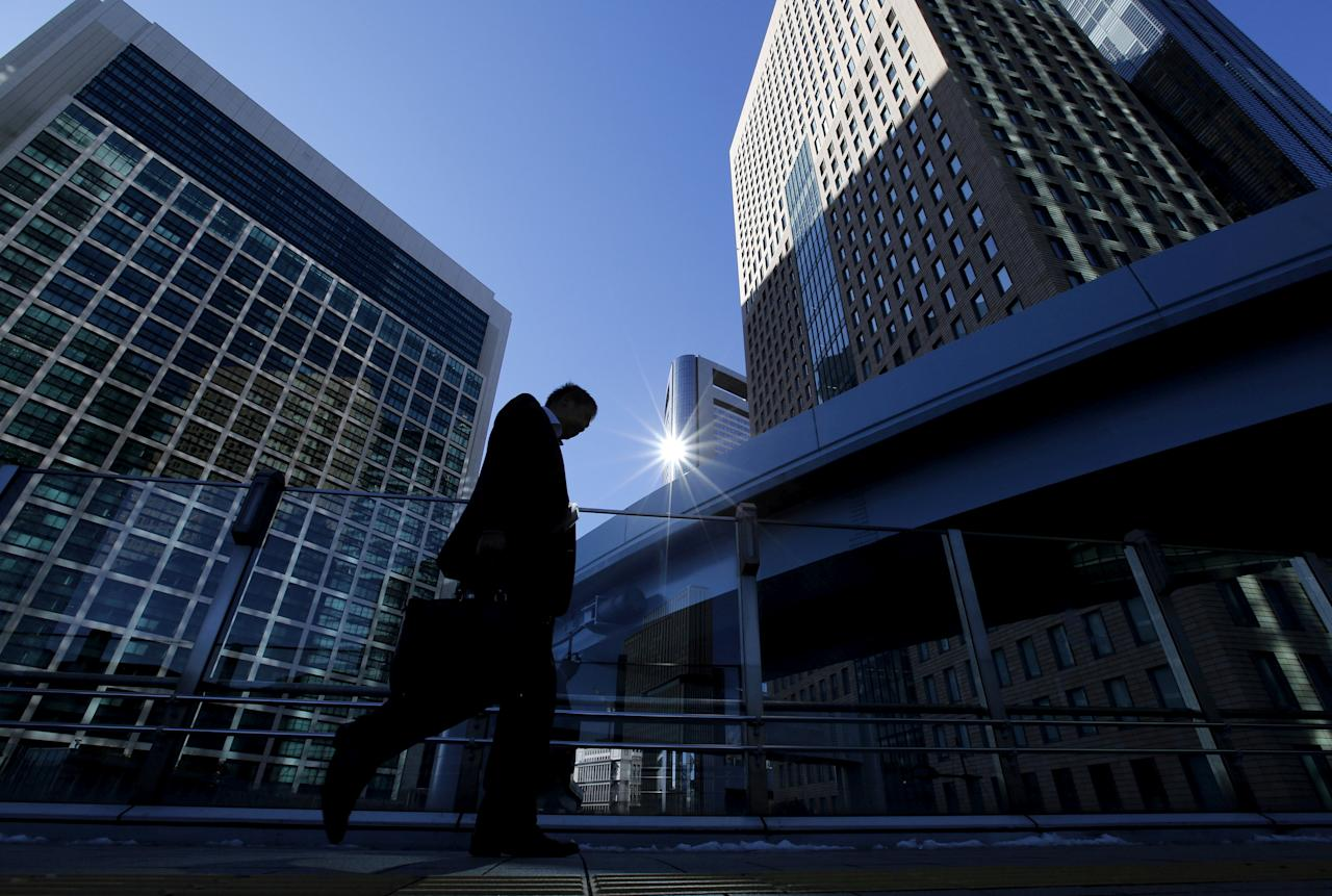 FILE PHOTO: A businessman walks in Tokyo's business district, Japan January 20, 2016.   REUTERS/Toru Hanai/File Photo