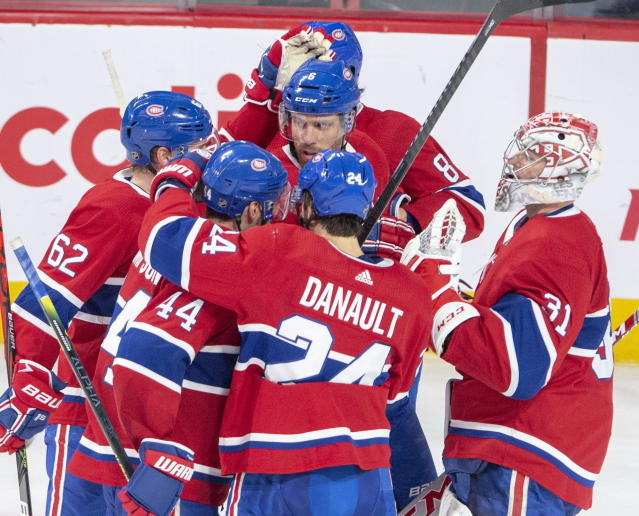 Montreal Canadiens defenceman Shea Weber, center, is congratulated by teammates after scoring the fourth goal against the New York Islanders during third period NHL hockey action, Tuesday, Dec. 3, 2019 in Montreal. (Ryan Remiorz/The Canadian Press via AP)