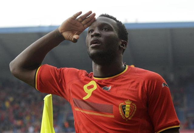 Belgium's Romelu Lukaku salutes after he scored against Luxembourg, during a friendly soccer match at the Cristal Arena stadium in Genk, eastern Belgium, Tuesday, May 26, 2014. Belgium will play against South Korea, Russia and Algeria in Group H of the World Cup 2014 in Brazil. (AP Photo/Yves Logghe)