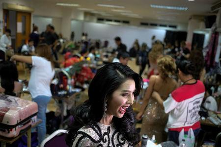 Contestant Wanmai Thammavong of Laos prepares backstage before the final show of the Miss International Queen 2016 transgender/transsexual beauty pageant in Pattaya, Thailand, March 10, 2017. REUTERS/Athit Perawongmetha