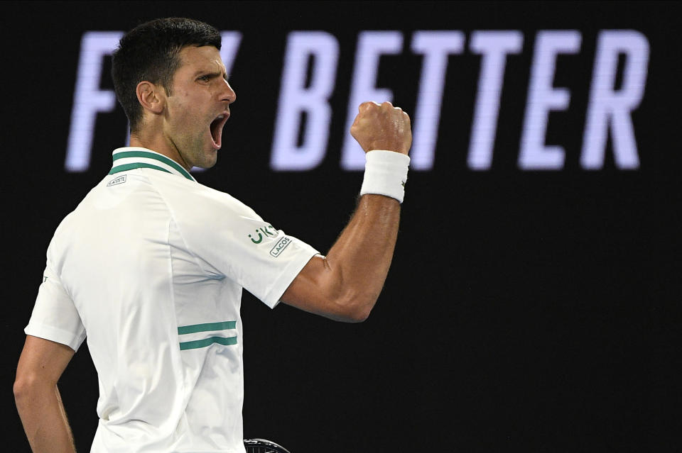 Serbia's Novak Djokovic reacts after winning a point against Russia's Daniil Medvedev in the men's singles final at the Australian Open tennis championship in Melbourne, Australia, Sunday, Feb. 21, 2021.(AP Photo/Andy Brownbill)