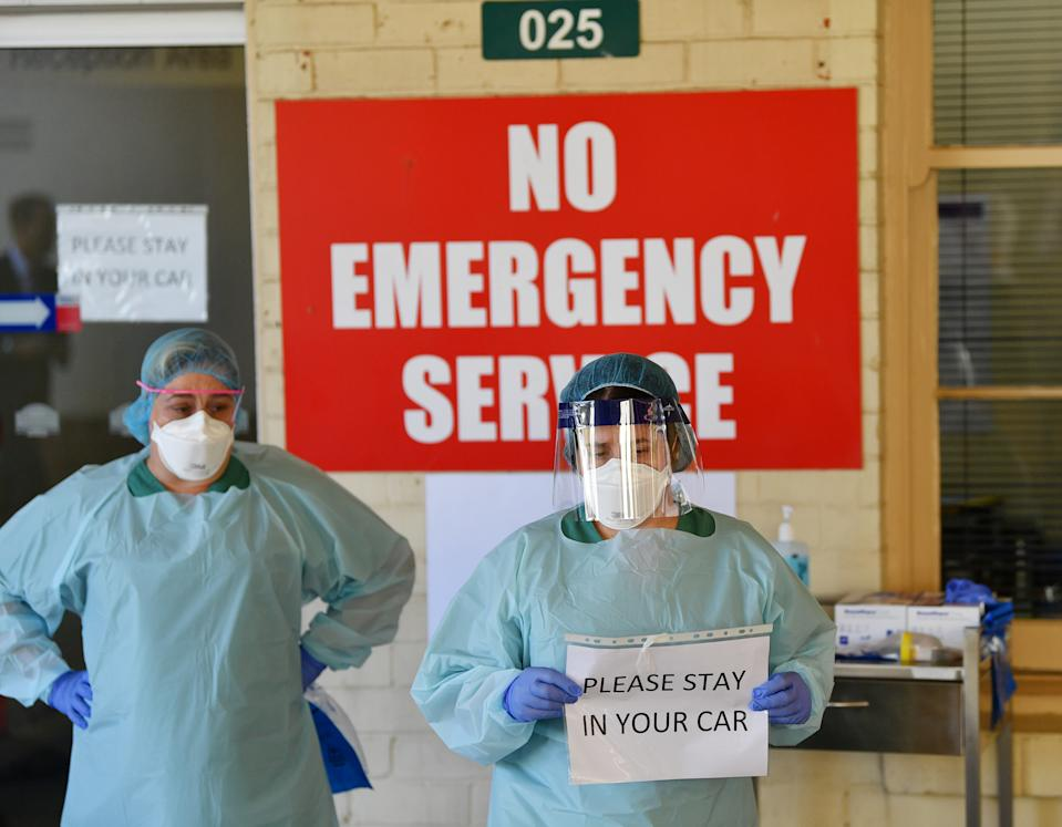 Two female medical staff wear PPE at a South Australian hospital. Source: AAP