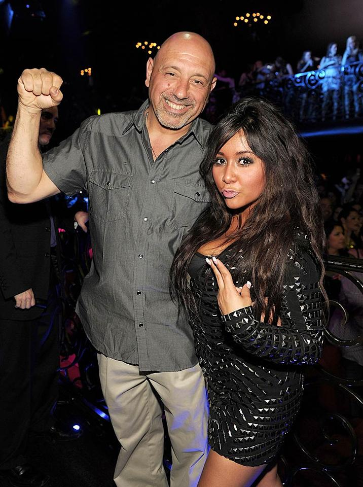 """Most gals heading out for a night of clubbing don't necessarily want their parents to join them, but not Snooki! Her dear old dad, Andy Polizzi, was ready to fist-pump, too. Like father, like daughter! Denise Truscello/<a href=""""http://www.wireimage.com"""" target=""""new"""">WireImage.com</a> - March 13, 2011"""