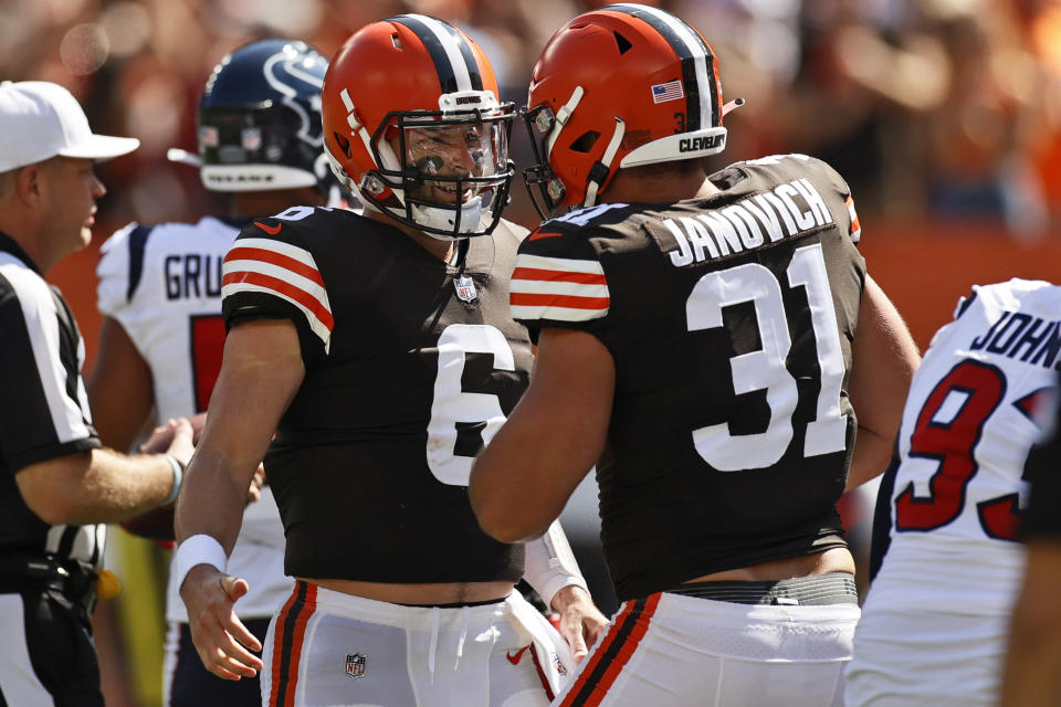 Cleveland Browns quarterback Baker Mayfield, left, celebrates with Andy Janovich after Janovich scored a 1-yard touchdown during the first half of an NFL football game against the Houston Texans, Sunday, Sept. 19, 2021, in Cleveland. (AP Photo/Ron Schwane)