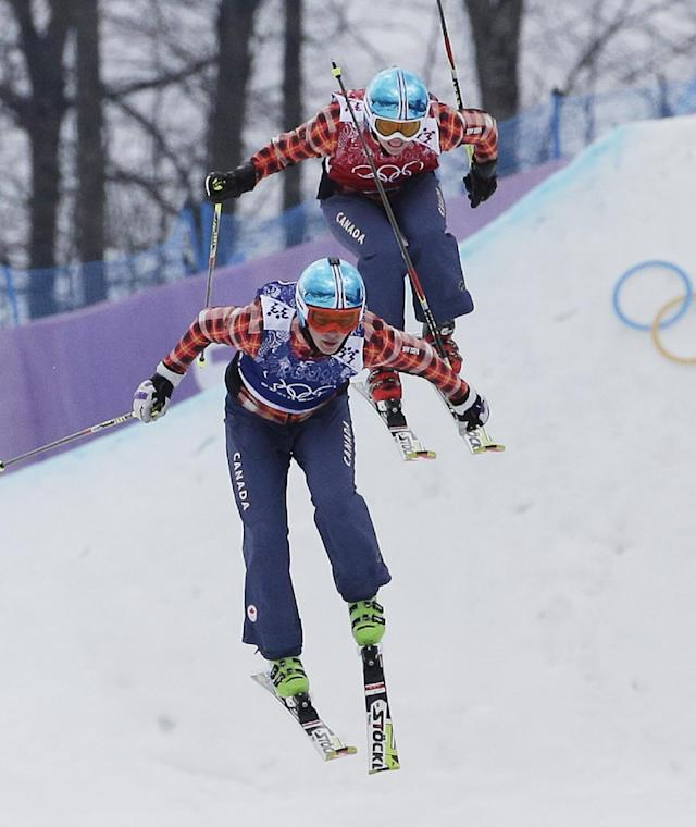 Canada's Marielle Thompson lands from the last jump to win the gold medal ahead of compatriot France's Ophelie David in the women's ski cross final at the Rosa Khutor Extreme Park, at the 2014 Winter Olympics, Friday, Feb. 21, 2014, in Krasnaya Polyana, Russia. (AP Photo/Andy Wong)