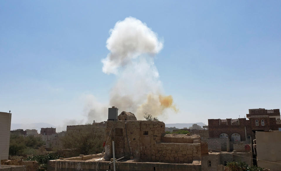 FILE - In this Mar. 7, 2021 file photo, smoke rises after Saudi-led airstrikes on an army base in Sanaa, Yemen. Saudi Arabia announced a plan Monday, March 22, 2021, to offer Yemen's Houthi rebels a cease-fire in the country's yearslong war and allow a major airport to reopen in its capital, the kingdom's latest attempt to halt fighting that has sparked the world's worst humanitarian crisis in the Arab world's poorest nation. (AP Photo/Hani Mohammed, File)