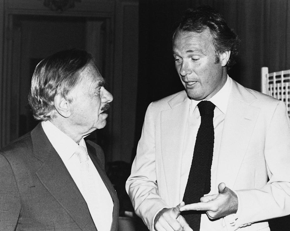 British film producers Nat Cohen (left) and Barry Spikings in conversation, circa 1982. (Photo by Richard Blanshard/Getty Images)