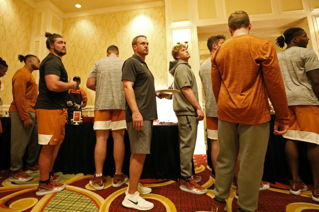 Texas Longhorns head coach Tom Herman lines up with the team for dinner, Friday Sept. 6, 2019 at the team hotel in Austin, Tx. ( Photo by Edward A. Ornelas )