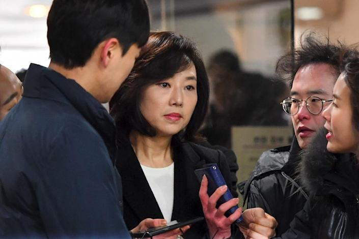 South Korea's former Culture Minister Cho Yoon-Sun (C) arrives at the Seoul Central District Court, on January 20, 2017 (AFP Photo/JUNG Yeon-Je)
