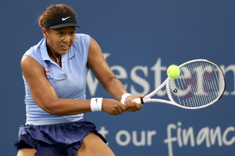 Defending champion Naomi Osaka of Japan will try to capture her third US Open title at the New York hardcourt tennis showdown that starts Monday (AFP/MATTHEW STOCKMAN)