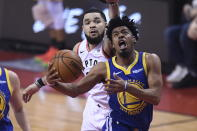Golden State Warriors guard Quinn Cook (4) drives past Toronto Raptors guard Fred VanVleet (23) during the first half of Game 1 of basketball's NBA Finals, Thursday, May 30, 2019, in Toronto. (Frank Gunn/The Canadian Press via AP)