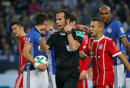 Soccer Football - Bundesliga - Schalke 04 vs Bayern Munich - Veltins-Arena, Gelsenkirchen, Germany - September 19, 2017   Referee Marco Fritz gets advice from the VAR before awarding a penalty to Bayern Munich   REUTERS/Wolfgang Rattay