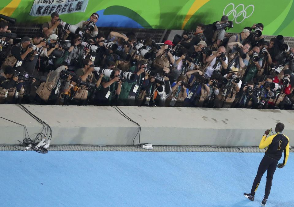Sprint great Usain Bolt poses for an army of photographers after winning the 100m race at the 2016 Rio de Janeiro Olympics.