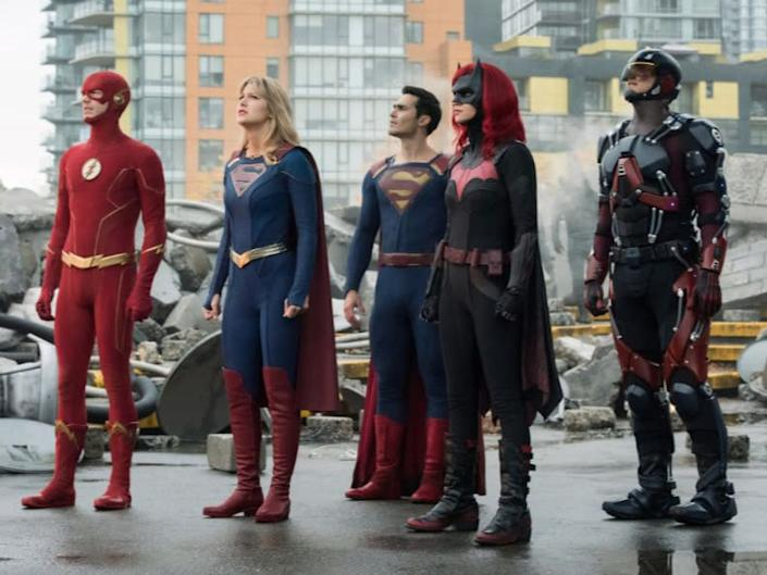 Supergirl (2nd left) with fellow Arrowverse heroesThe CW