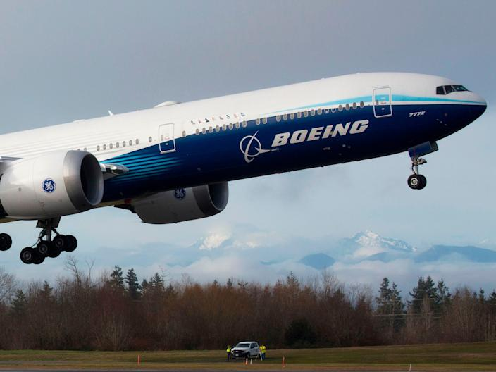 A Boeing 777X aircraft departing Paine Field.