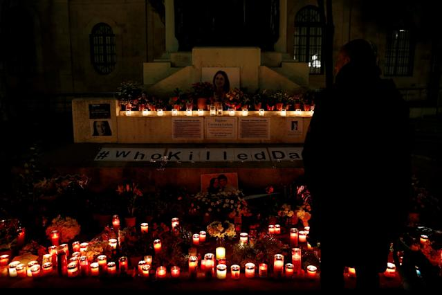 A man looks at a makeshift memorial for assassinated Maltese journalist Daphne Caruana Galizia, who was killed by a car bomb five months ago, in Valletta, Malta March 16, 2018. The makeshift memorial also has a picture of murdered Slovak journalist Jan Kuciak and his fiancee Martina Kusnirov. REUTERS/Darrin Zammit Lupi TPX IMAGES OF THE DAY